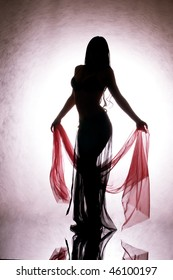 A silhouette of a dancing woman with a red silk in your hand.