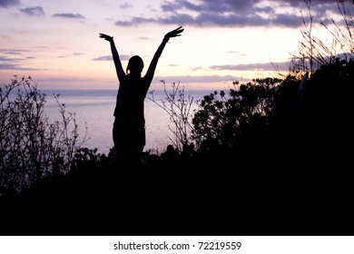 silhouette of a dancing woman in the sunset