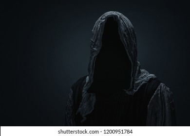 Silhouette of a death over dark gray background with copy space