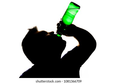 Silhouette of Depressed Young Man in Alcohol addiction isolated on White Background