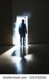 Silhouette of detective in doorway