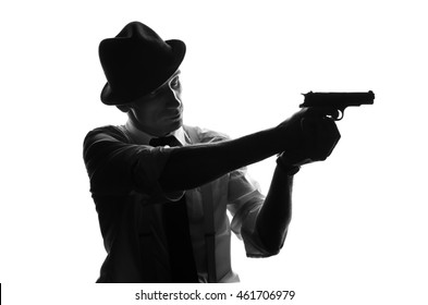 Silhouette of detective with a gun aiming to aside