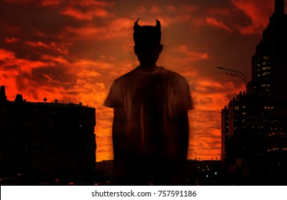 silhouette of the devil on the background of the red bloody sky