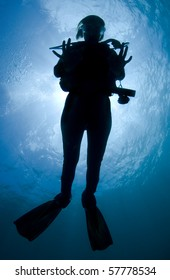 Silhouette of a diver in the Caribbean Sea