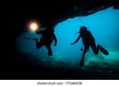 silhouette divers in a cave, location: fuerteventura , canary islands