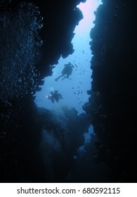 Silhouette of Divers over the Canyon in Dahab, the Red Sea in Egypt