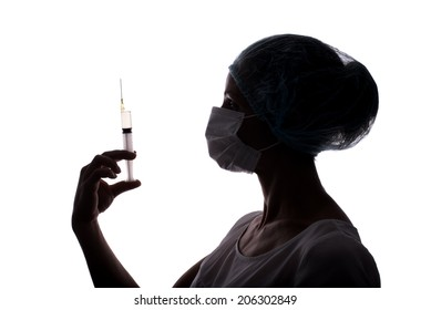 Silhouette of doctor woman using syringe