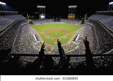 Silhouette of Dodger fans cheer and point from grandstands overlooking home plate at National League Championship Series (NLCS), Dodger Stadium, Los Angeles, CA on October 12, 2008