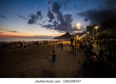 Silhouette of Dois Irmaos Mountain and sunset at Ipanema beach