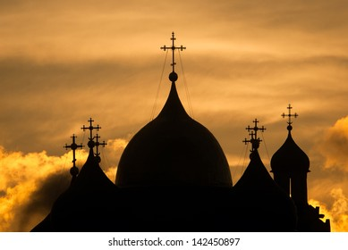 silhouette dome of the church at sunset