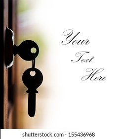 Silhouette of door keys hanging on the open door with white background and copy space for text. The keys represents concept of security of wealth or safe home or unlocking of the potential, etc