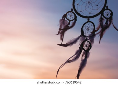 Silhouette of dream catcher in the twilight time, pastel toned, selective focus and blurred background