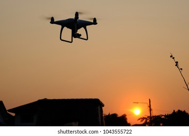 silhouette drone fly at sunset evening.