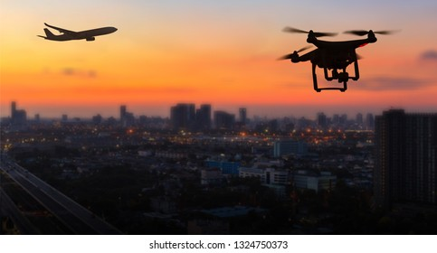Silhouette of drone flying near an airport with airplane, no drone zone concept