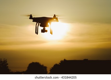 Silhouette drone / quadcopter at sunset