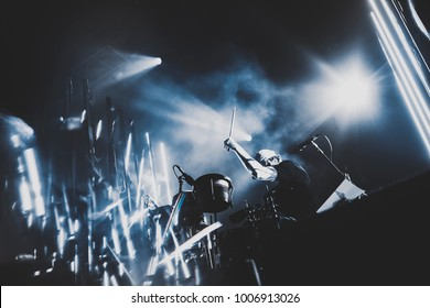 silhouette of drummer / percussion / cymbal /drum player playing on drums on a concert . Club lights, artist show.
