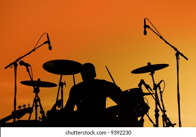 Silhouette of Drummer at sunset