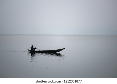 silhouette of a dug out african wooden canoe on lake kivu in Congo