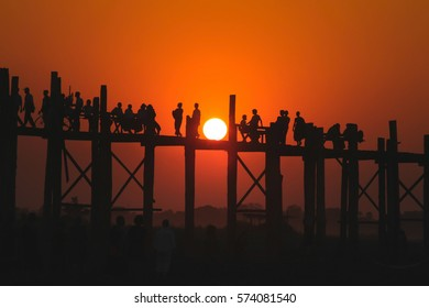 Silhouette during sunset at U Bein Bridge, Mandalay, Myanmar, grain texture style