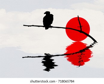 The silhouette of an eagle perched on a tree branch above the water. The bird's silhouette along with the sun and clouds create a blurred reflection in the water below.