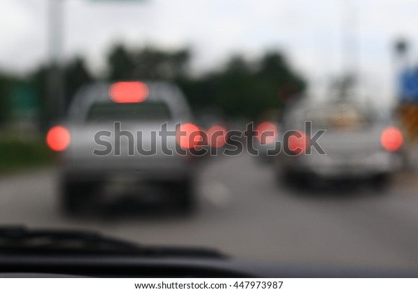 Silhouette edge Bokeh on the road in the morning. In Thailand.Abstract blurred background : Traffic jam in the morning rush hour. in-Thailand.