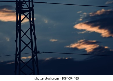 A silhouette electric tower with dark blue sky background unique photograph