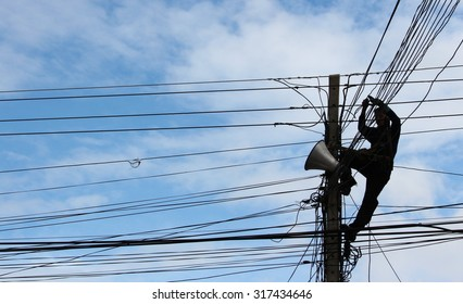 Silhouette Electrician Man on electric poles. Electrical repairs are made to restore them to normal  ( Silhouette style )