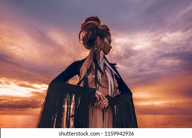 silhouette of elegant woman on the beach at sunset and