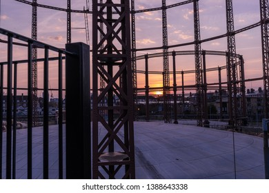 Silhouette of an empty gas storage cylinders against the dusk sunset sky in  London.