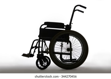 Silhouette Of Empty Wheelchair In Studio