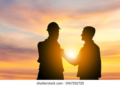 Silhouette of Engineer and foreman worker with clipping path soul brother handshake, thumb clasp handshake or homie handshake sunset background