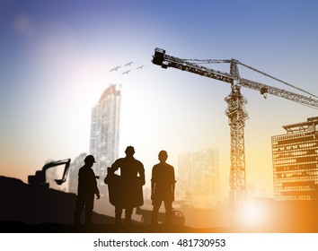 silhouette engineer looking at blueprints over Blurred construction site.CSR ESG Business on industry, People, Science,Signs, Symbols, Technology, Transportation concept