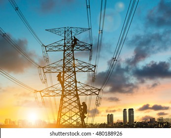 silhouette engineer repair and electrical installation work on high voltage pylons over Blurred construction site.CSR ESG Business on industry, People, Science, Technology, Transportation concept.