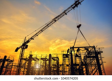 Silhouette of engineer and safety officer looking construction worker pouring a concrete column on scaffolding in construction  site