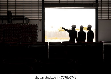 Silhouette of engineer working at manufacturer