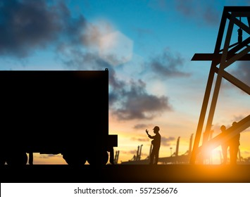 Silhouette engineers waving to the truck to get to send customers over blurred natural background sunset pastel.Business Logistics and Transportation concept.flare light.