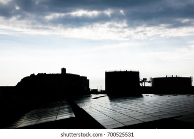 silhouette of factory building and solar panel.
