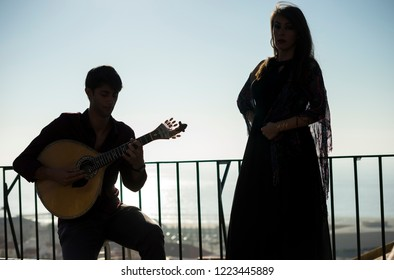 Silhouette of fado band with Tagus river as background, Lisbon, Portugal