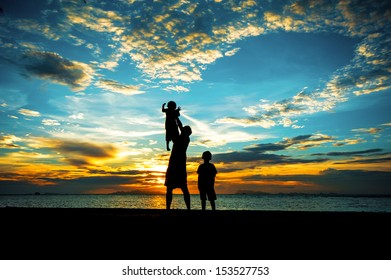 silhouette of family at dusk.