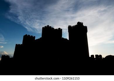 Silhouette of the famous castle Castillo de la Mota in Medina del Campo at dusk, Valladolid.