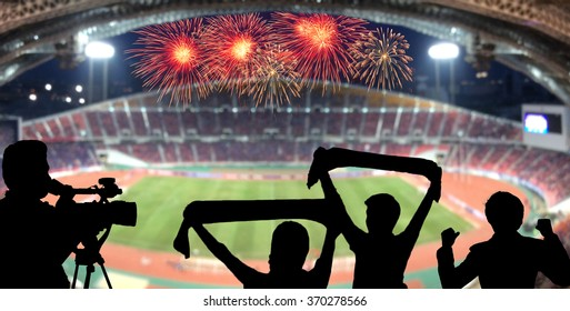 The silhouette of fan club over the panorama of Abstract blurred photo of fan sport at stadium with firework, sport background concept