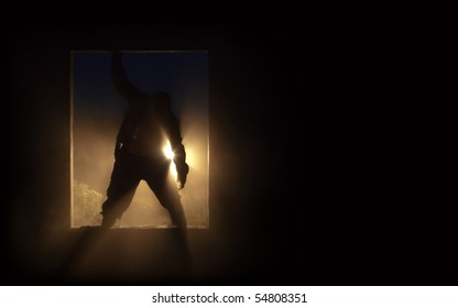 The silhouette of the fat spooky zombie in the doorway.