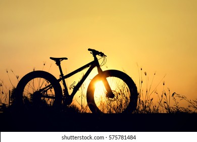 silhouette fatbike or snow bike at sunset