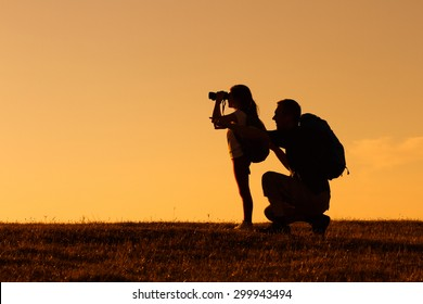 Silhouette of father and daughter hiking together.Father and daughter hiking