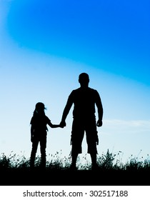 silhouette father and daughter holding hands