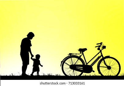 silhouette father and son and vintage bike  walking on blurry colorful sky at sunset time