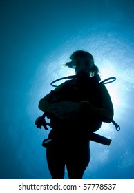 Silhouette of a female diver in the Caribbean Sea