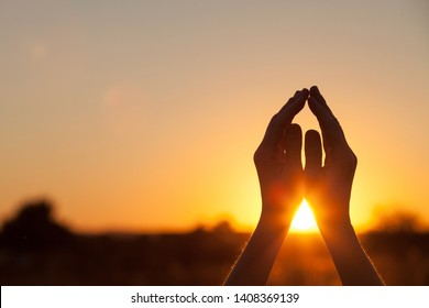 silhouette of female hands during sunset. Concept of life.