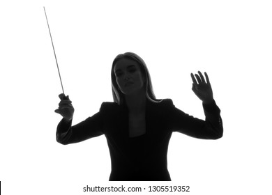 Silhouette of female orchestral conductor on white background
