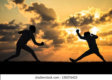 Silhouette fencers with sunset